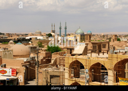 A roof top view across Yazd one of Iran's oldest cities, focusing particularly on the spectacular Jameh Mosque in - Stock Photo