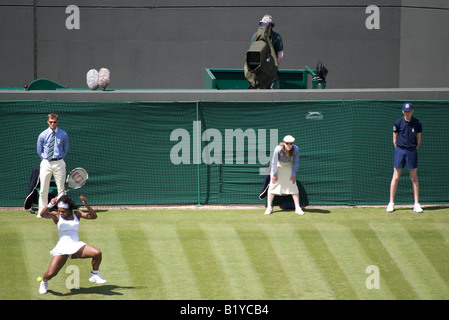 Serena Williams returns a powerful shot to Kaia Kanepi during the opening day of Wimbledon 2008 - Stock Photo