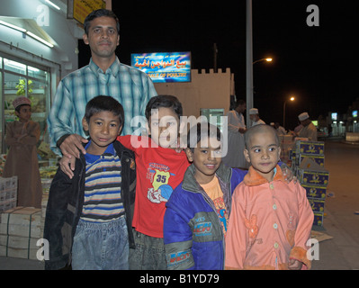 Family at night in Barka Oman - Stock Photo
