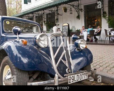 Citroen traction avant 1940s car in front of Sofitel Metropole Hotel, Hanoi, Vietnam - Stock Photo