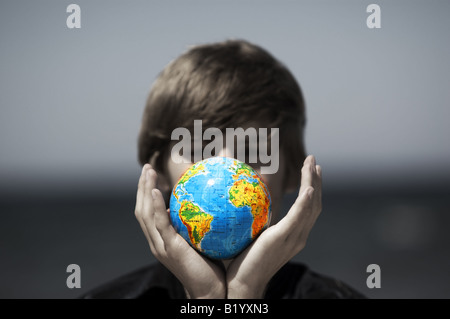Earth globe in hands protected. Ideal for Earth protection concepts, recycling, world issues, enviroment themes - Stock Photo