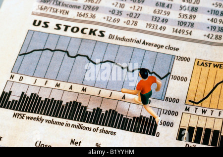 Toy figure running on stock market pages - Stock Photo