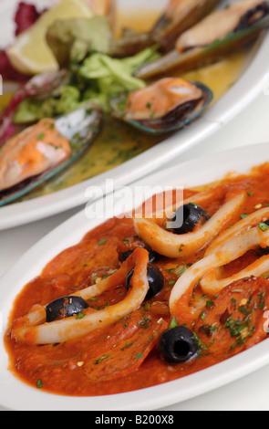 Calamari Napoli and Mussels starters Italian food in restaurant - Stock Photo