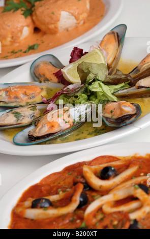 New Zealand Mussels with Calamari and Stuffed mushrooms Italian food in Restaurant - Stock Photo