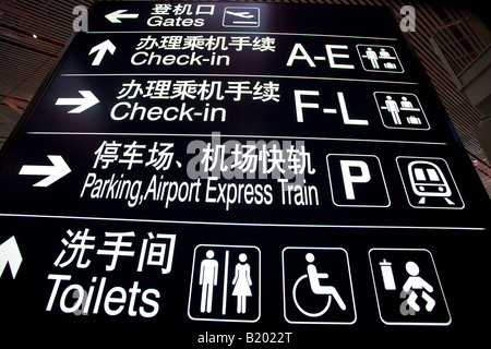Signpost in Terminal Three of Beijing Capital International Airport China - Stock Photo