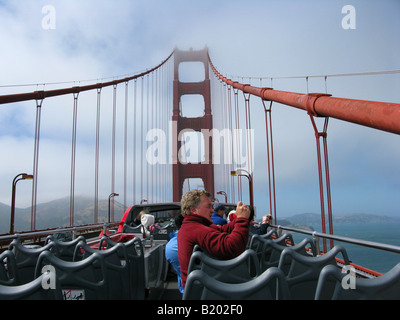 A tour bus crossing the Golden Gate Bridge in San Francisco, California on June 16. 2008. (Photo by Kevin Bartram) - Stock Photo