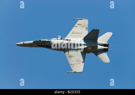 A Boeing F/A-18 flies at an air show in Quonset Point RI. - Stock Photo