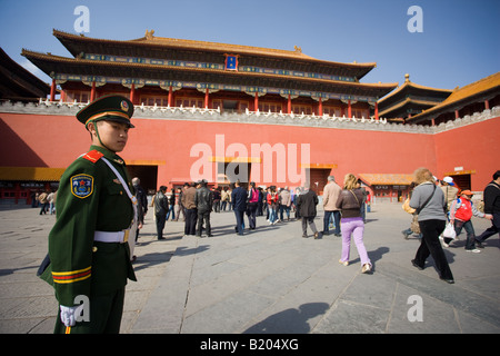 Soldier and tourists at the entrance to the Forbidden City Beijing China - Stock Photo