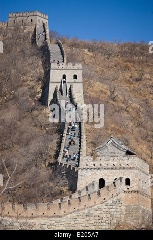 The ancient Great Wall of China snaking through mountains at Mutianyu north of Beijing formerly Peking - Stock Photo