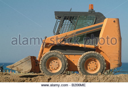 Mini excavator digger digging machine vehicle blue sky bagger bugger INDUSTRY Technology Modernisation commercial - Stock Photo