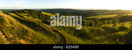 An evening panorama looking SW from the Cotswold scarp at Painswick Beacon, Gloucestershire - Stock Photo