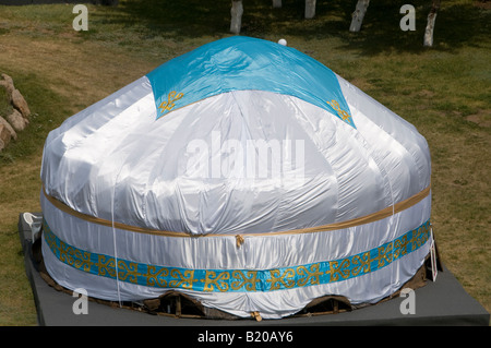 A traditional yurt or ger which portable, round tent covered with felt and used as a dwelling by nomads in the steppes - Stock Photo