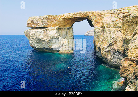 Panorama of Natural arch at Dwejra Point on the island of Gozo, Malta - Stock Photo