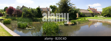 The duck pond in the Cotswold village of Willersey, Gloucestershire - Stock Photo