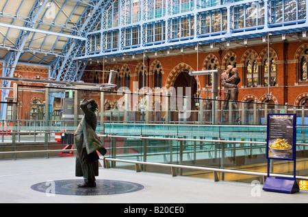 The statue of Sir John Betjeman in St Pancras Station,London. - Stock Photo