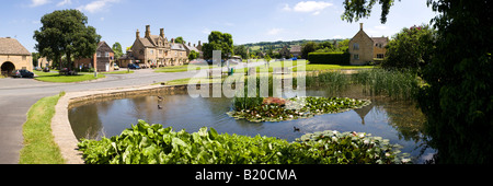 The duck pond in the Cotswold village of Willersey, Gloucestershire UK - Stock Photo