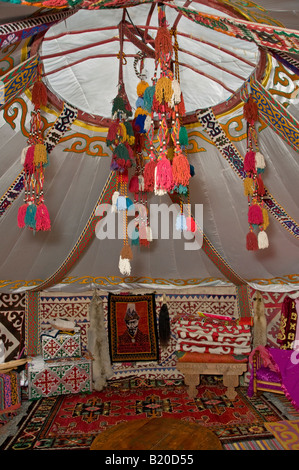 Interior of a traditional yurt or ger which portable, round tent covered with felt and used as a dwelling by nomads - Stock Photo