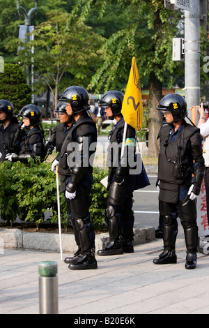 Japanese Police officers in riot gear at the G8 summit in Sapporo. Stock Photo