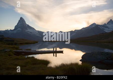 Matterhorn 4478 m reflected in Stellisee 2573 m Zermatt Valais Switzerland - Stock Photo