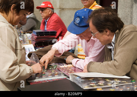 SPAIN Madrid Bottle cap collector trades and sell collections in Plaza Mayor on Sunday morning Men and women view - Stock Photo