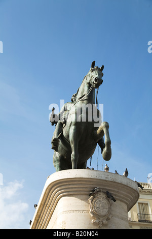 SPAIN Madrid Statue of Mounted King Charles III in Puerto del Sol plaza viewed from below - Stock Photo