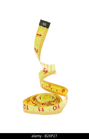 Measuring tape suspended in the air on white background - Stock Photo