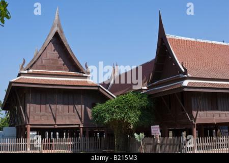 Traditional wooden Thai Buddhist temple Wat Yai Suwannaram, Phetchaburi, Thailand - Stock Photo