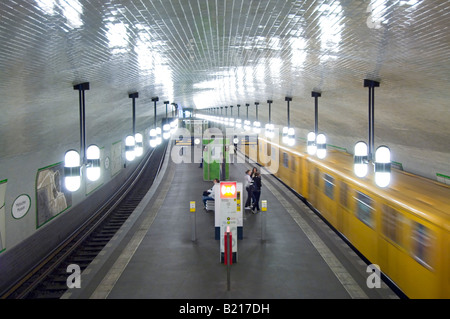 Slow shutter speed for motion blur of a U-Bahn train coming into Märkisches Museum station. - Stock Photo