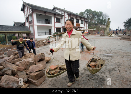 Woman at work building new tourist centre at Dazu Rock Carvings Mount Baoding Chongqing China - Stock Photo