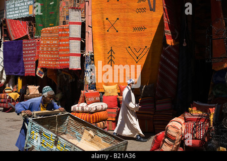 Marrakech shop selling Moroccan rugs and carpets - Stock Photo