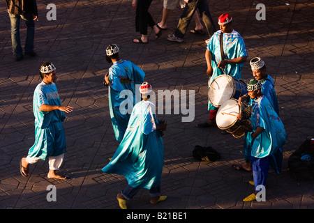 Marrakech dancers and musicians in the Djemaa el fna - Stock Photo