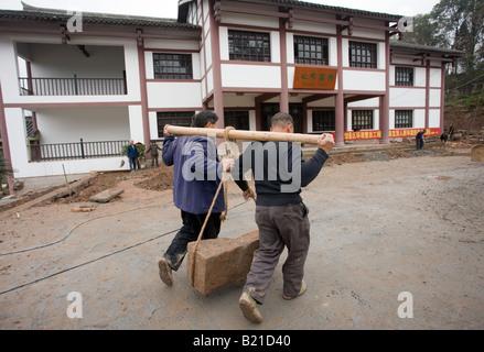 Men at work building new tourist centre at Dazu Rock Carvings Mount Baoding Chongqing China - Stock Photo