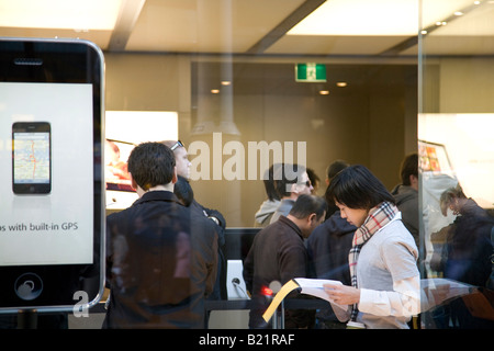 queue inside the apple store in Sydney as the iphone 3G goes on sale in australia - Stock Photo