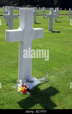 Floral bouquet laid at the tomb of an unknown soldier at the  Normandy American Cemetery and Memorial - Stock Photo