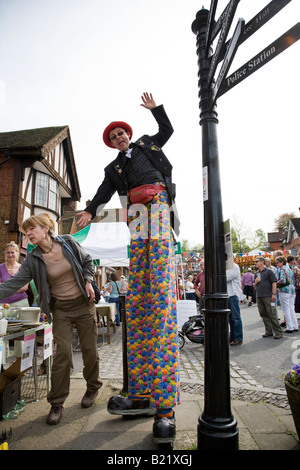 A stiltwalker during the biennial Haslemere Charter Fair, Haslemere, Surrey, England. - Stock Photo