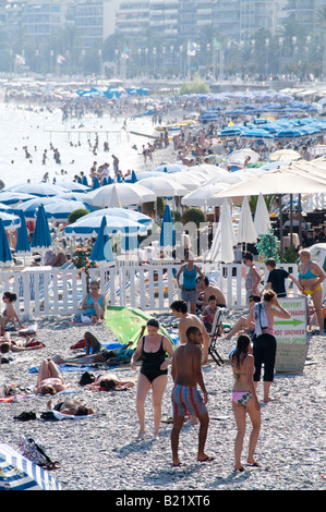 People on the beach, Anges Bay, Nice, South France - Stock Photo