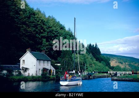 Sailboat on Crinan Canal Argyll Strathclyde Scotland GB - Stock Photo