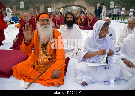 Hindus Jains and Buddhists attend a PRAYER FOR WORLD PEACE at the RAJ GHAT Ghandis eternal flame in 2008 NEW DELHI - Stock Photo