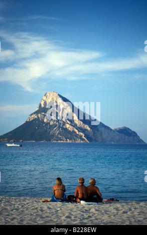 People at beach Spiaggia Lo Istana Porto San Paolo Isola di Tavolara in background Gallura Sardinia Italy - Stock Photo