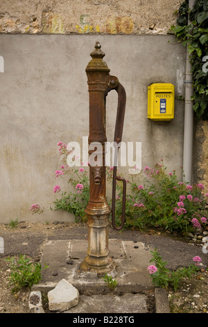 old public water pump in the street in France 26 June 2008 - Stock Photo