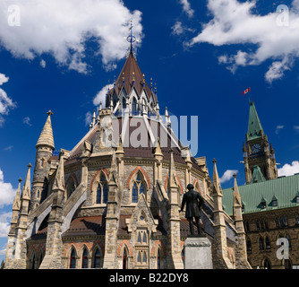 Renovated Library and Center Block with Peace Tower of Parliament Buildings federal government legislature in Ottawa - Stock Photo