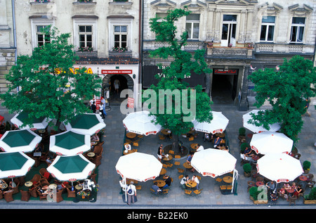 Restaurants with sunshades on Main Market Square Cracow Poland - Stock Photo