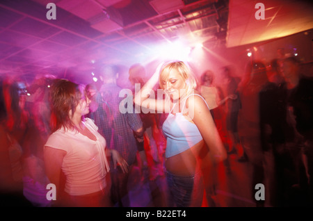 Two young girls dancing in Park Disco Club Warsaw Poland - Stock Photo