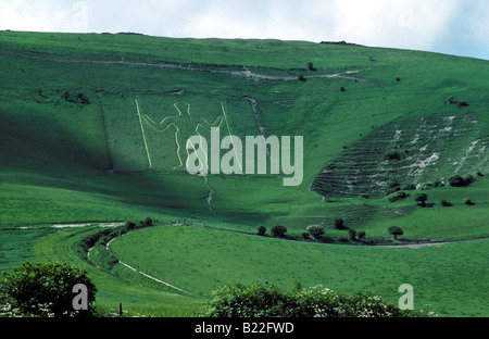 Figure of a man cut into the chalk of Windover Hill on the South Downs at Wilmington East Sussex Southern England - Stock Photo