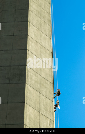Two people repel down the side of a building in Boston Ma. - Stock Photo