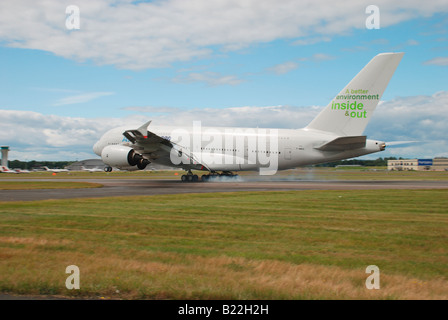airbus industries A380 landing at farnborough 2008 with smoke coming from the tyres on touch down - Stock Photo