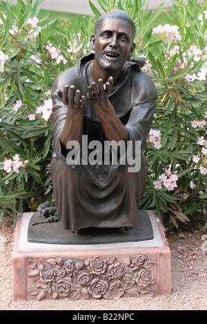 Bronze statue of Saint Francis in the garden of St. Mary's Basilica, Phoenix, Arizona, USA. - Stock Photo