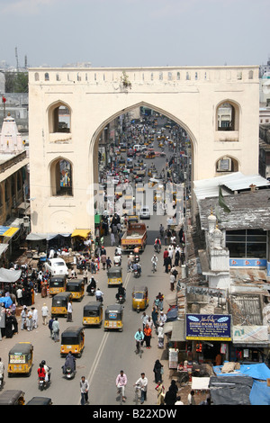 Traffic runs through an arch in the Laad Bazaar area of Hyderabad, India. - Stock Photo