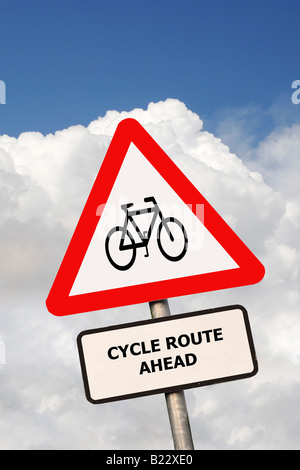 British Triangular road sign warning drivers that a cycle route is ahead - Stock Photo