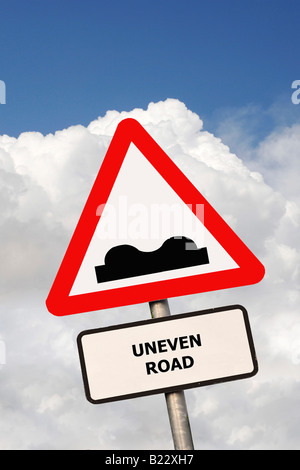 British Triangular road sign warning drivers that the road ahead is uneven - Stock Photo